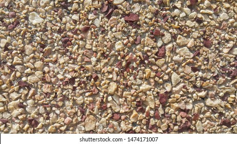surface structure created by spraying, sifted sand painted crimson and cream small stones, building facades, wall, largest texture