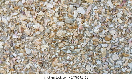 surface structure created by spraying, sand sifted painted crimson and cream small stones, gravel walls, building facades, the largest texture