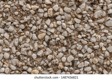 surface structure created by spraying, sand sifted painted crimson and cream small stones, gravel walls, building facades, the small texture