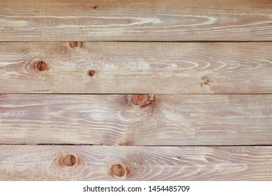 The surface of the table is planks in dark red tones with white gaps as the background.