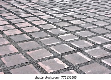 Surface texture of old square ceramic tile floor at outdoor