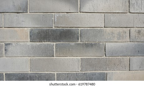 surface texture pattern of grey brick wall, rough and grunge