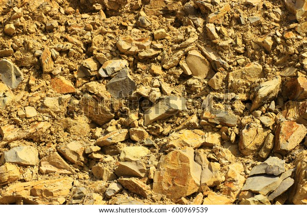 the surface texture of the soil is covered with fragments of the mineral in various sizes and shapes