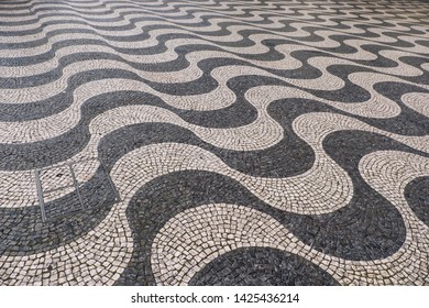 Surface of unique cobble stone road in Lisbon