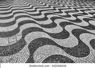 Surface of unique cobble stone road in Lisbon in black and white