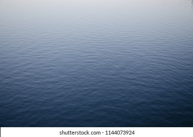 The surface of water reflecting the light in its different angles.