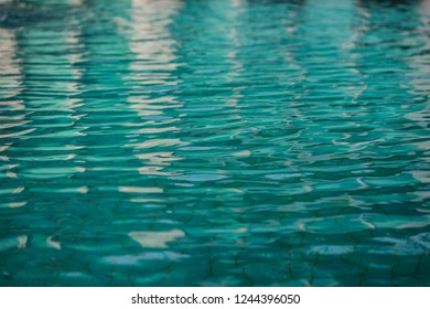 Surface of water wave and reflection on swimming pool