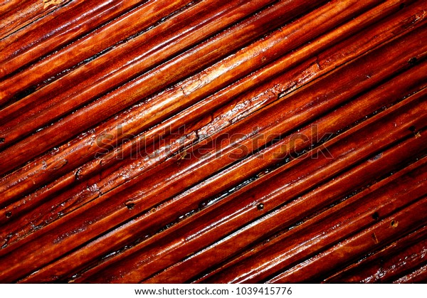 Surface of wooden laths varnished. Diagonal lines. Glaring.