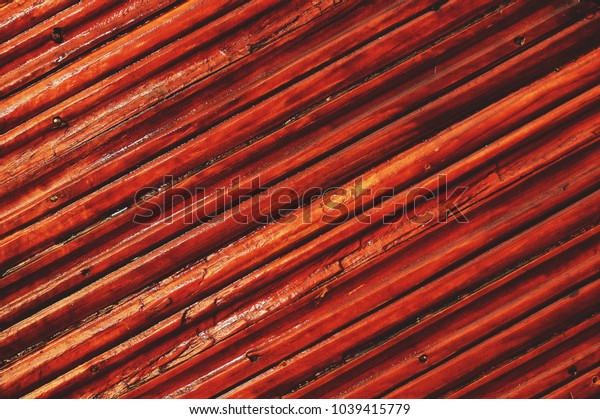 Surface of wooden laths varnished. Diagonal lines.