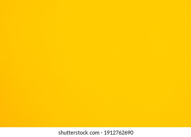 surface of yellow paper for background.
