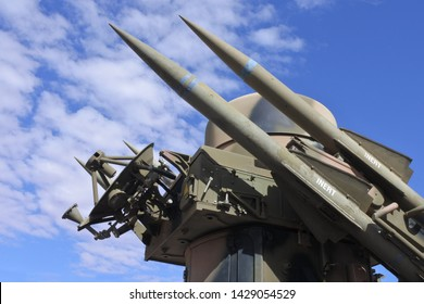 Surface-to-air missiles with radar guidance system pointing to the sky.