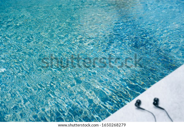 Surfboard floating in pool outside on a sunny day