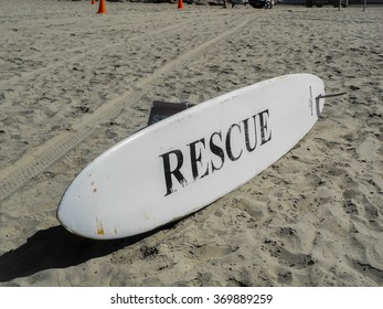 Surfboard with the letters RESCUE at at a beach in California.