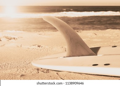 The surfboard with long fin tone effect on the beach sand in sunny day in Sunshine Coast Australia