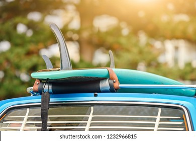Surfboard on roof rack of vintage car, South Australia
