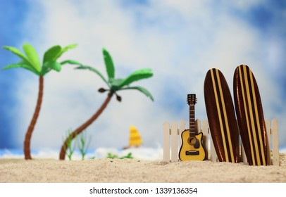 Surfboard on Tropical Beach - Shallow DOF, focus on top of guitar and fence