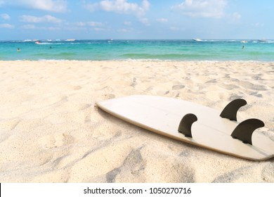 Surfboard on tropical beach in summer. seascape of summer beach with sea, blue sky background.