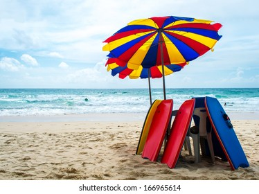 Surfboard and Umbrella on the beach