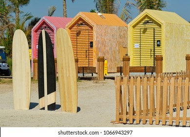 Surfboards and beach bathing cabins in Dubai, United Arab Emirates