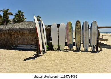 surfboards on sand beach in Baja, Mexico