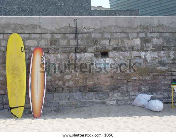 surfboards standing against a wall.