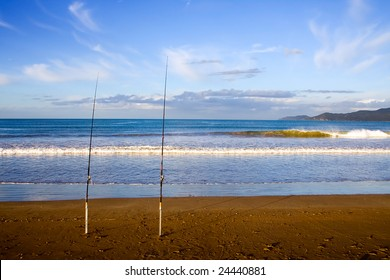 Surfcasting rods in the sand at Taipa Beach on a beautiful summers evening, Northland, New Zealand,