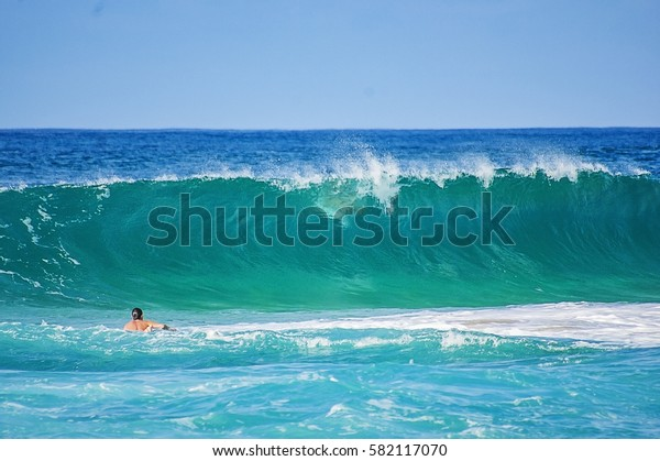 Surfer about to take on the Big Waves of North Shore Hawaii