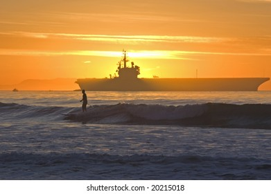 Surfer and Aircraft Carrier along the California Coast