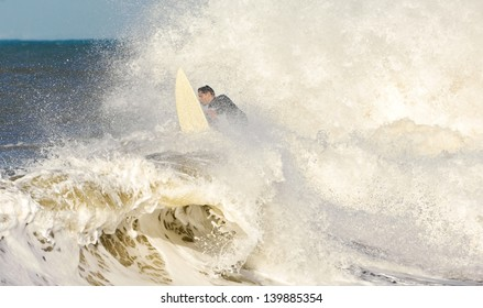 Surfer among splashes and waves