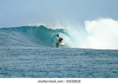 Surfer in barrel getting tube view, Mentawai Islands, Indonesia
