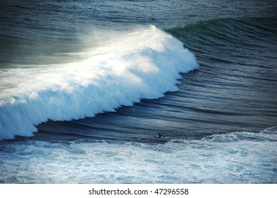 Surfer and the big wave