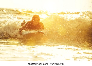 Surfer boy ready to get on the board