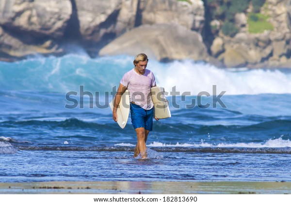 surfer with broken surfboard