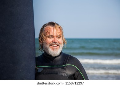 Surfer with a carefree attitude after leaving the sea