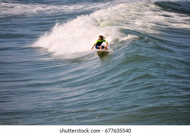 Surfer Carving a Amazing Wave off the Coast in the Outer Banks of North Carolina