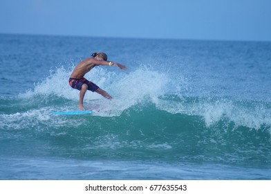 Surfer Carving A Wave in the Beautiful Outer Banks of North Carolina