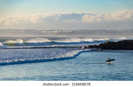 A surfer at the coast