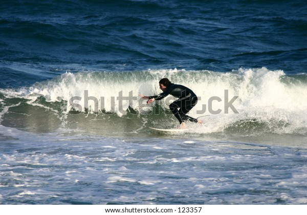 Surfer cutting a wave