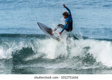 Surfer defies gravity on lip of wave. Taken January 21, 2018. Location Veterans Park Redondo Beach, California.