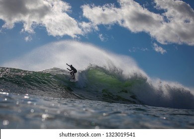 A surfer drops a wave at Pleasure Point in Capitola, California / United States on February 10, 2019.