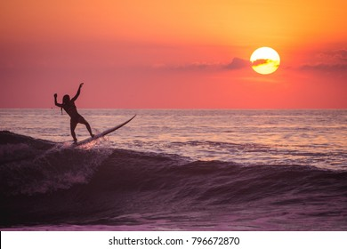 Surfer at dusk.
