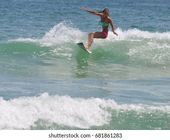Surfer Girl Enjoying the Waves at the Beach