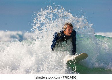 Surfer with his board in the wild waves