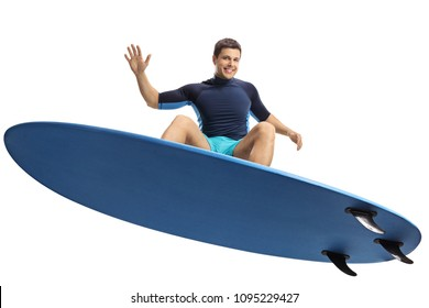 Surfer jumping with a surfboard isolated on white background