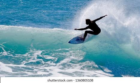 Surfer in Malibu, CA USA - January 24 2015
