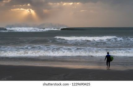 Surfer on the beach of Viareggio in Toscana - Italy
