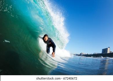 Surfer on Blue Wave Getting Barreled