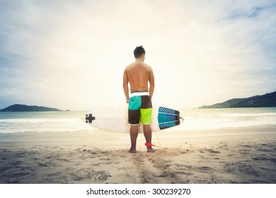 Surfer on the ocean beach at sunset on patong puket thailand,vintage Instagram retro hipster