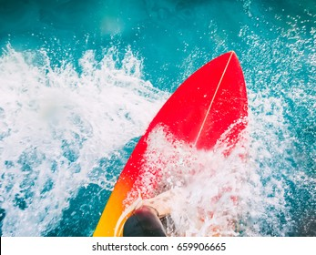 Surfer on red surfboard ride on wave. Surfing in blue ocean