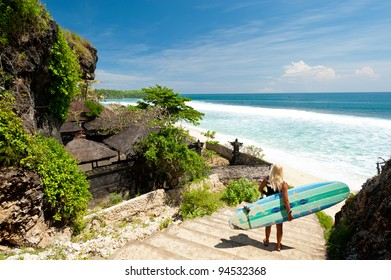A surfer overlooking  a beach in Bali